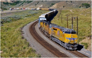 A freight train like this Union Pacific manifest rolling along I-80 in Utah's Echo Canyon may have a plethora of hazardous materials as part of its lading; so may the truck on the adjacent interstate. An Emergency Response Guidebook can be a vital tool to help emergency responders take proper action if trouble strikes. (©Paul Burgess August 2014; used with permission)